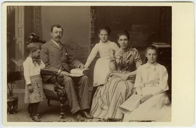 Unidentified man, woman, two young girls, and young boy