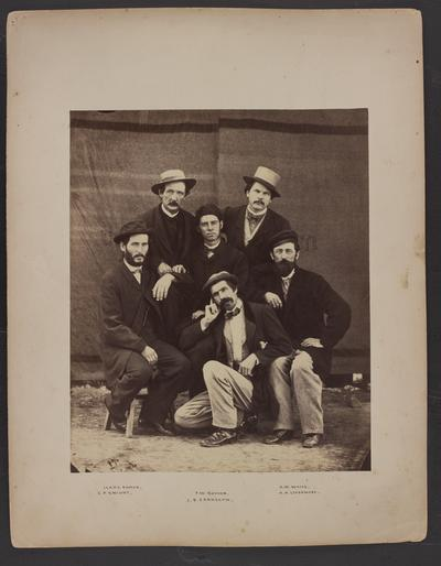 Posed group photo; six men, four kneeling, two standing, all wearing coat and tie, bottom of photo reads Isaac Damon, E.P. Knight, F.W. Boyden, J.B. Earnshaw, A.W. Waite, A.A. Livermore