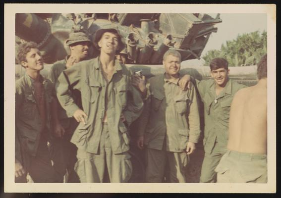 Soldiers in front of machinery, Joe Parisi on right