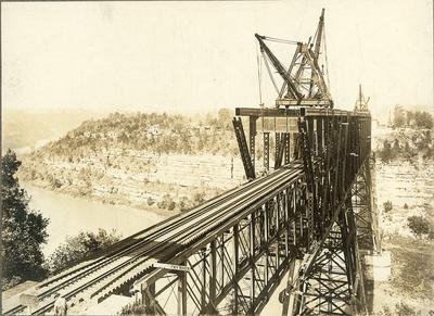 Construction on High Bridge-man beside CAUTION sign