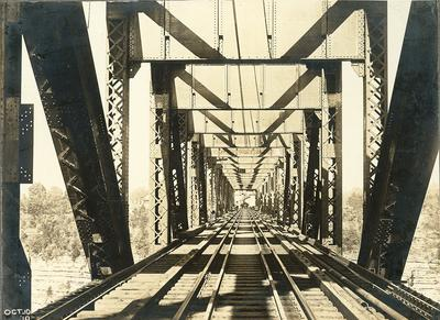 Railroad tracks of High Bridge-men walking ahead