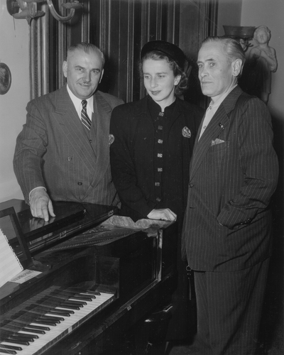 Presentation of Niles' honorary doctor of music degree; Left to Right: Dr. Luther Richman; Rena; and John Jacob Niles; Cincinnati Conservatory of Music