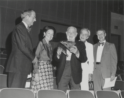 Presentation of plaque following birthday concert; Left to Right: Adrian Doran, Mignon Doran, John Jacob Niles, Rena Niles, and unidentified man; Morehead State University, Morehead, KY