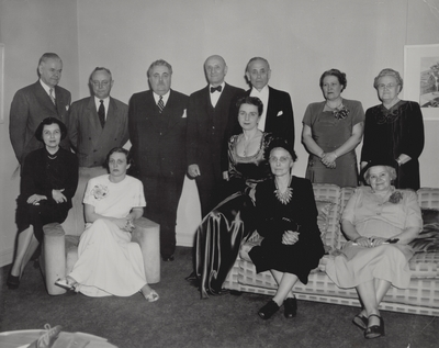 Performance at Indiana University; Dr. Herman B. Wells, President (3rd from left), John Jacob Niles (5th from left), Rena Niles (center); Bloomington, Indiana