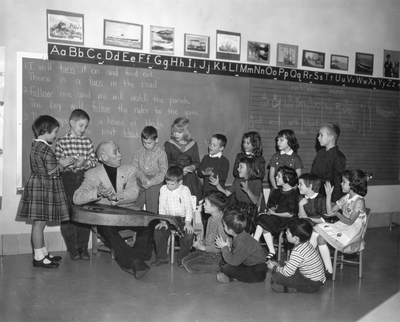 John Jacob Niles performing for kindergarten class at The Lexington School; Lexington, KY
