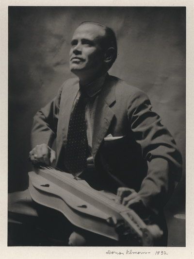 John Jacob Niles playing a traditional purchased dulcimer; New York City; Doris Ulmann-signed and dated