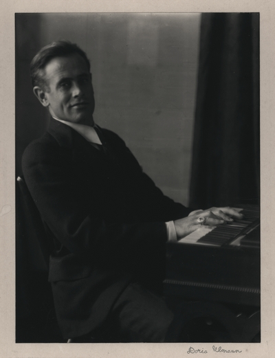 Portrait of John Jacob Niles seated at harpsichord owned by Doris Ulmann, taken at her apartment in New York City; Doris Ulmann-signed