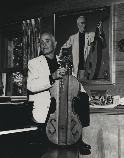 John Jacob Niles posed with dulcimer before Hammer portrait; Boot Hill Farm; Jack Cobb