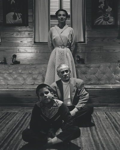 John Jacob Niles and Rena Niles with son on John Ed in living room at Boot Hill Farm; Eugene Meatyard