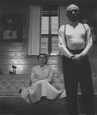 Rena Niles on sofa, John Jacob Niles with back to camera; Living room; Boot Hill Farm; Eugene Meatyard