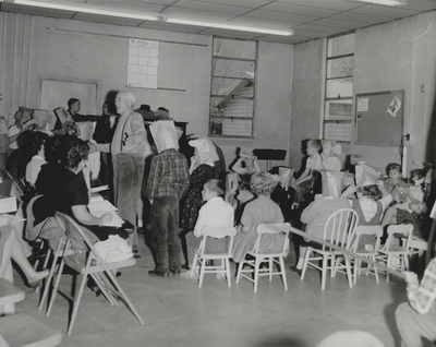 Performance by John Jacob Niles for children and dramatization of folk ballads by children; Harlan County, KY