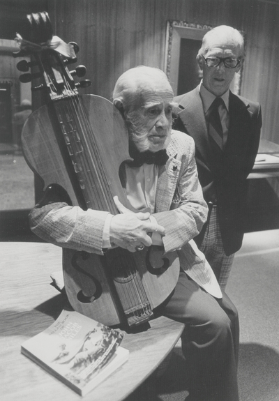John Jacob Niles with dulcimer and unidentified man after concert in King Library North; University of Kentucky; Lexington, KY
