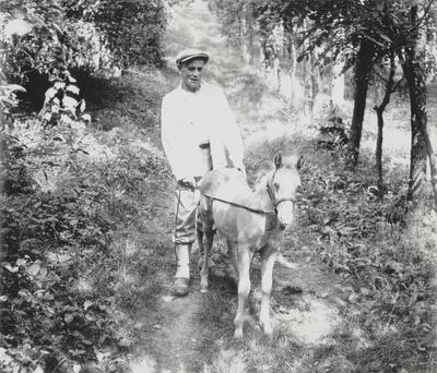John Jacob Niles schooling a pony foal; Boot Hill Farm; Van Coke