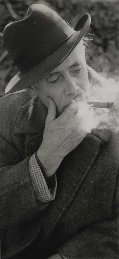 John Jacob Niles smoking a cigar