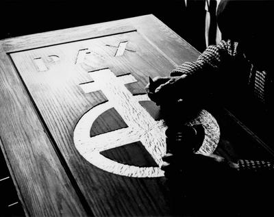 John Jacob Niles carving the doors for St. Hubert's Church, Boot Hill Farm; Jack Cobb