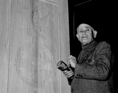 John Jacob Niles carving the doors for St. Hubert's Church, Boot Hill Farm; Jack Cobb