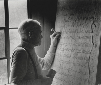 John Jacob Niles carving the doors for St. Hubert's Church; Boot Hill Farm; Van Coke