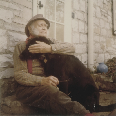 John Jacob Niles with dog Rosie; Boot Hill Farm