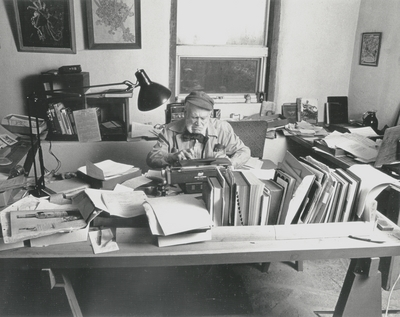 John Jacob Niles working on autobiography at typewriter in pony barn; Boot Hill Farm; Steve Mitchell