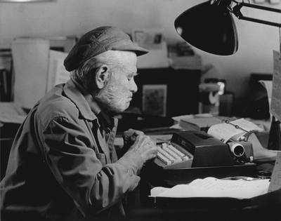 John Jacob Niles working on autobiography at typewriter in pony barn, Boot Hill Farm; Steve Mitchell