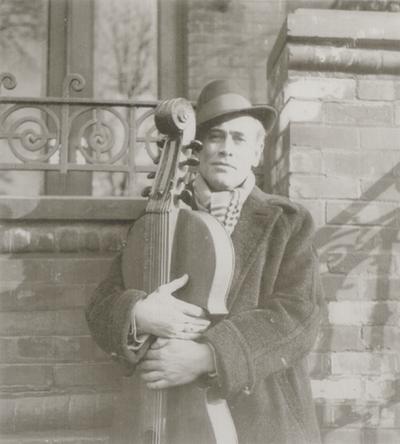 John Jacob Niles holding dulcimer; Albany, New York