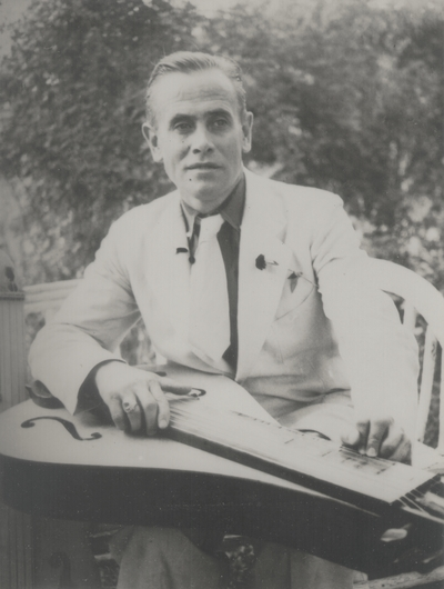 John Jacob Niles with dulcimer, taken at home of Sam Elliott; Pittsburgh, Pennsylvania