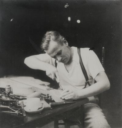John Jacob Niles carving scroll of dulcimer; Boot Hill Farm
