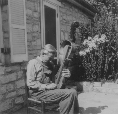 John Jacob Niles carving scroll of dulcimer, Boot Hill Farm