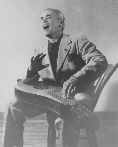 John Jacob Niles seated with dulcimer pose-used most often for publicity; Van Coke