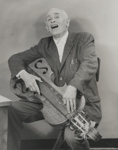 John Jacob Niles with dulcimer; promotional photo; St. Louis Post-Dispatch