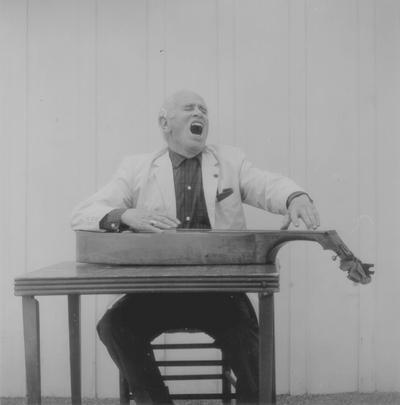 John Jacob Niles posed with dulcimer; Boot Hill Farm; Eugene Meatyard