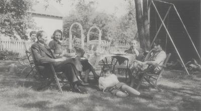 Three Lipetz family snapshots taken at Slingerland's home in New York; M. Moloslov, E. Slingerland, Vasile Lipetz, Harold Slingerland, Rena's aunt, and Van Slingerland lying on ground