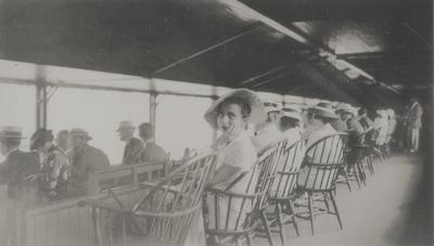 Snapshots of Rena Lipetz Niles; in hat at Saratoga Springs racetrack