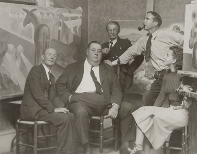 Frank Long (second from right), Rena Niles (far right) in Long Studio with unidentified man; Berea, KY