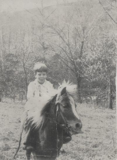 Tom Niles on a pony named Plum; Boot Hill Farm