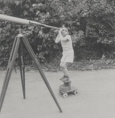 John Ed Niles looking through telescope