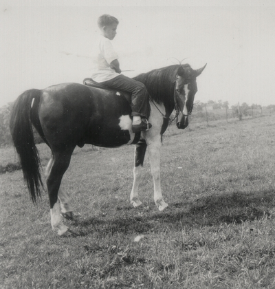 Tom Niles on pony; Boot Hill Farm