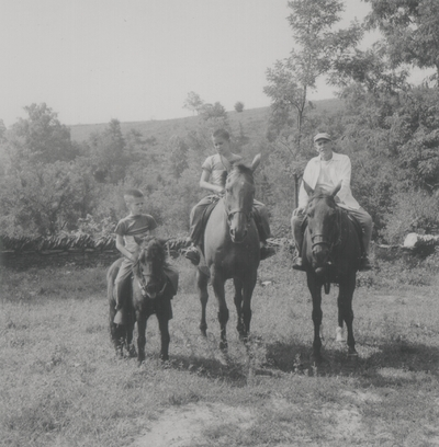 On horseback at Boot Hill Farm; Left to right: Rena, John Ed, Tom, and John Jacob Niles