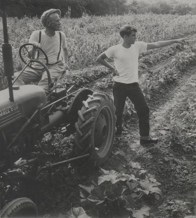 John Jacob Niles on tractor with Tom Niles in a field on Boot Hill Farm; Van Coke