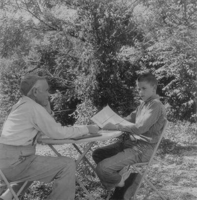 John Jacob Niles with John Ed Niles outdoors at Boot Hill Farm