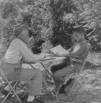 John Jacob Niles with John Ed Niles outdoors at Boot Hill Farm
