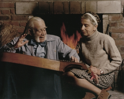 John Jacob Niles and Rena Niles in front of fireplace; Boot Hill Farm; Tony Leonard