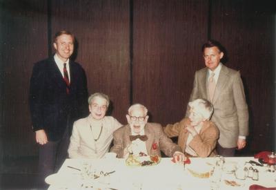 John Jacob Niles 87th birthday; Left to right: Arch Mainous, Jr., Rena and John Jacob Niles, Carolina Hammer, and Thomas Charles Barnes; Arch Mainous, Jr. and Rena Niles
