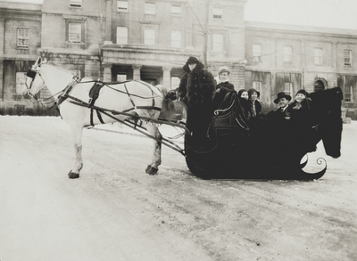 John Jacob Niles (2nd from left) with Marion Kerby (far right) in sleigh during tour of Holland
