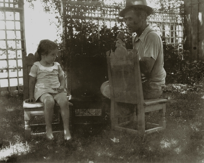 Chair caner with unidentified girl possibly daughter