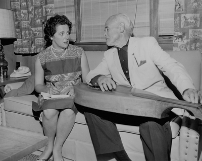 John Jacob Niles being interviewed by a female journalist
