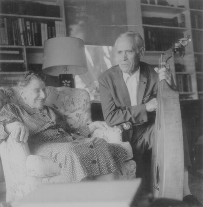 Miss Henrietta Child, daughter of folk songwriter Francis J. Child, seated with John Jacob Niles, taken at the home of Eleanor Churchill; Berea, KY