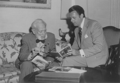 Tom Barnes (right) Trust Officer Citizen's Union Bank with John Jacob Niles used for bank calendar