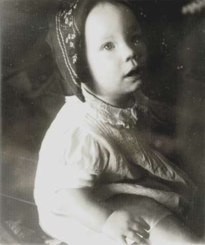 Finnish child wearing traditional headdress; photo given to John Jacob Niles at a concert in Finland