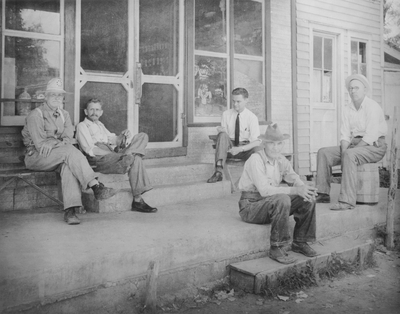 Men sitting on the front porch of a country store in Western Kentucky; John Jacob Niles